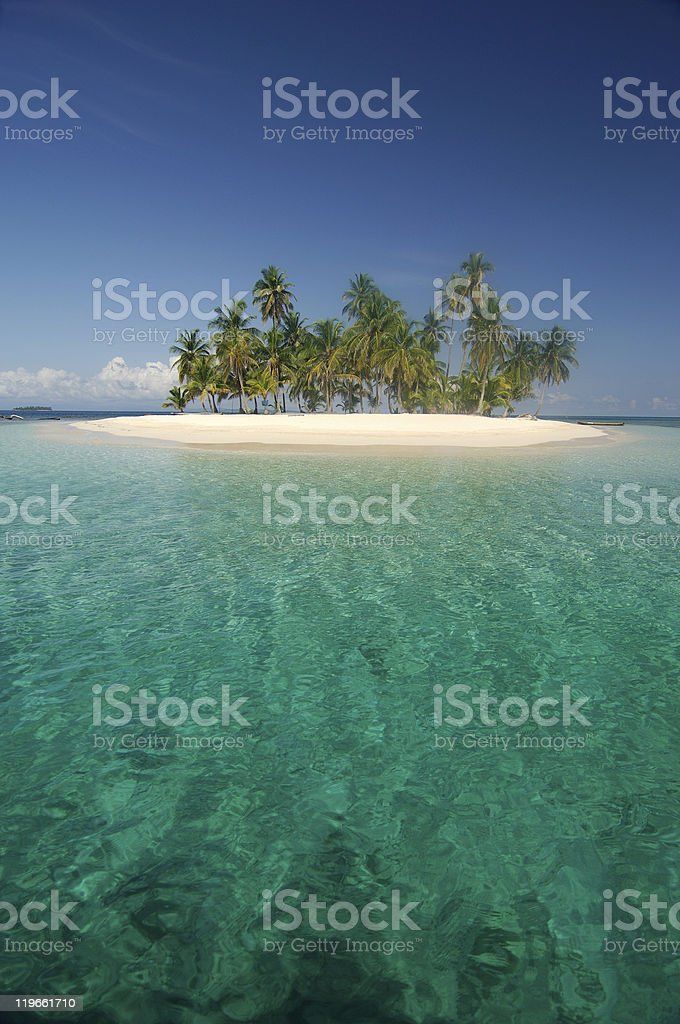 Small tropical island with clear blue water stock photo