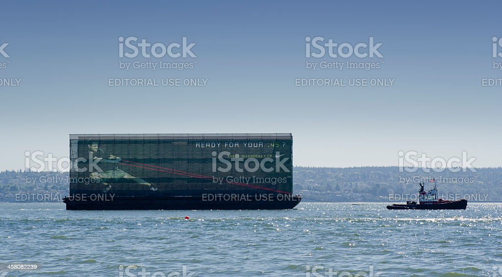 Small Tugboat pulling big Nike Advertising Trailer royalty-free stock photo
