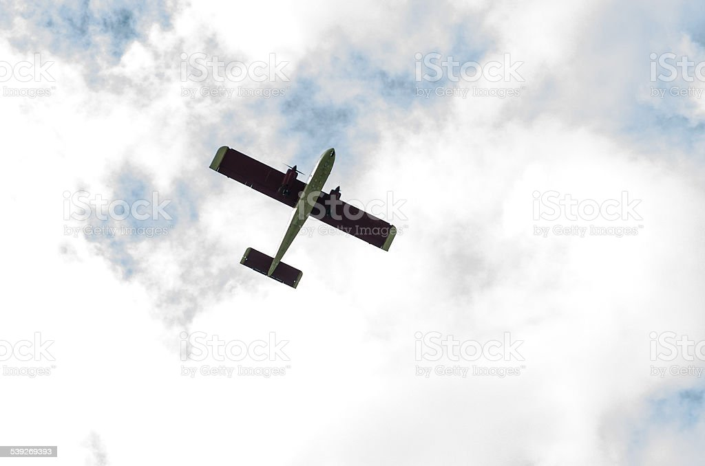 small twin engine plane in sky stock photo