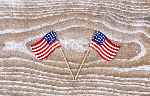 istock Small USA flags on white rustic wooden boards 537882840