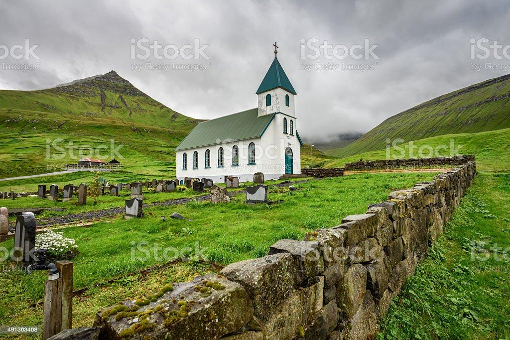 Small village church with cemetery in Gjogv, Faroe Islands, Denmark stock photo