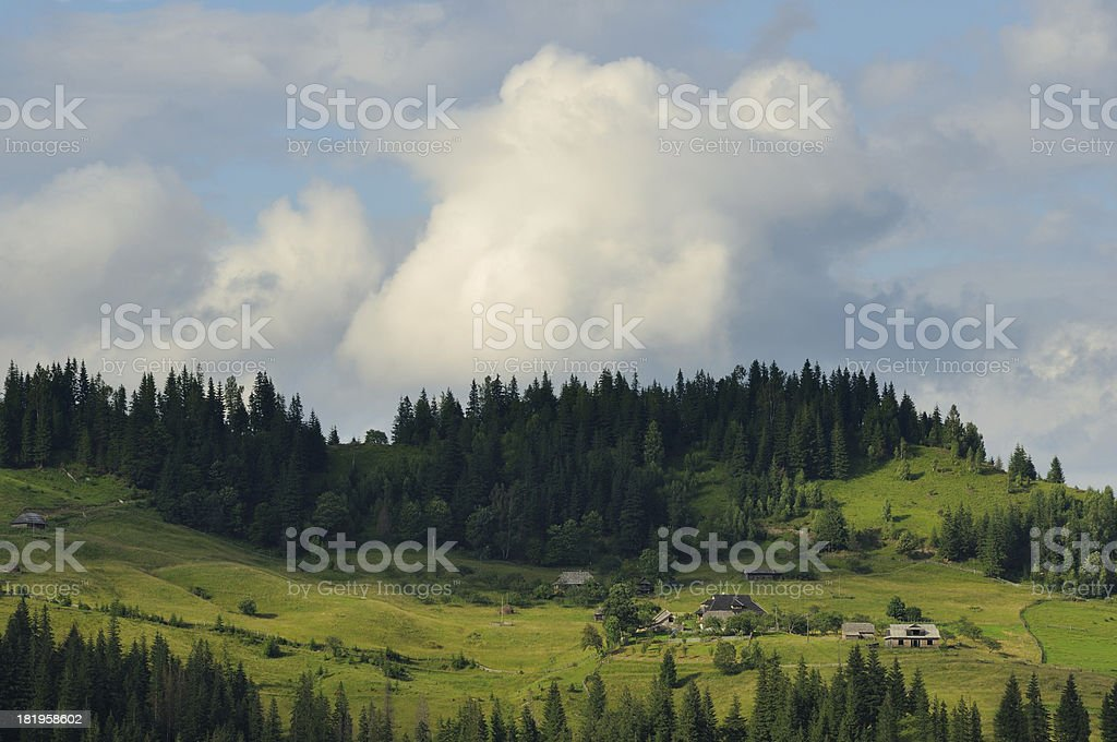 Small village houses in summer mountains royalty-free stock photo