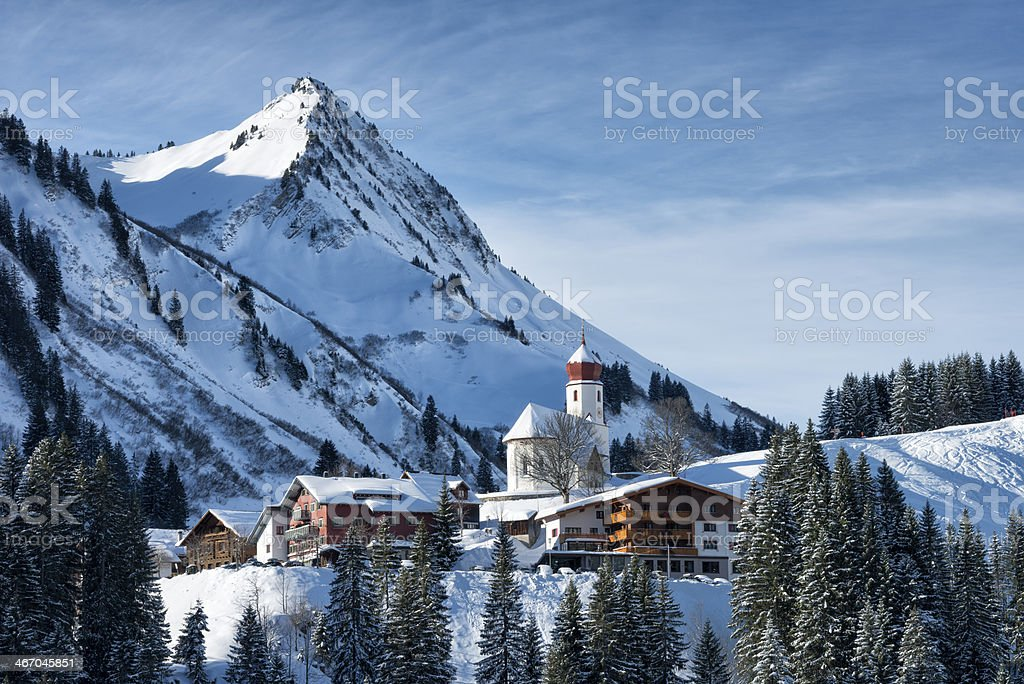 small village in snowy mountains stock photo
