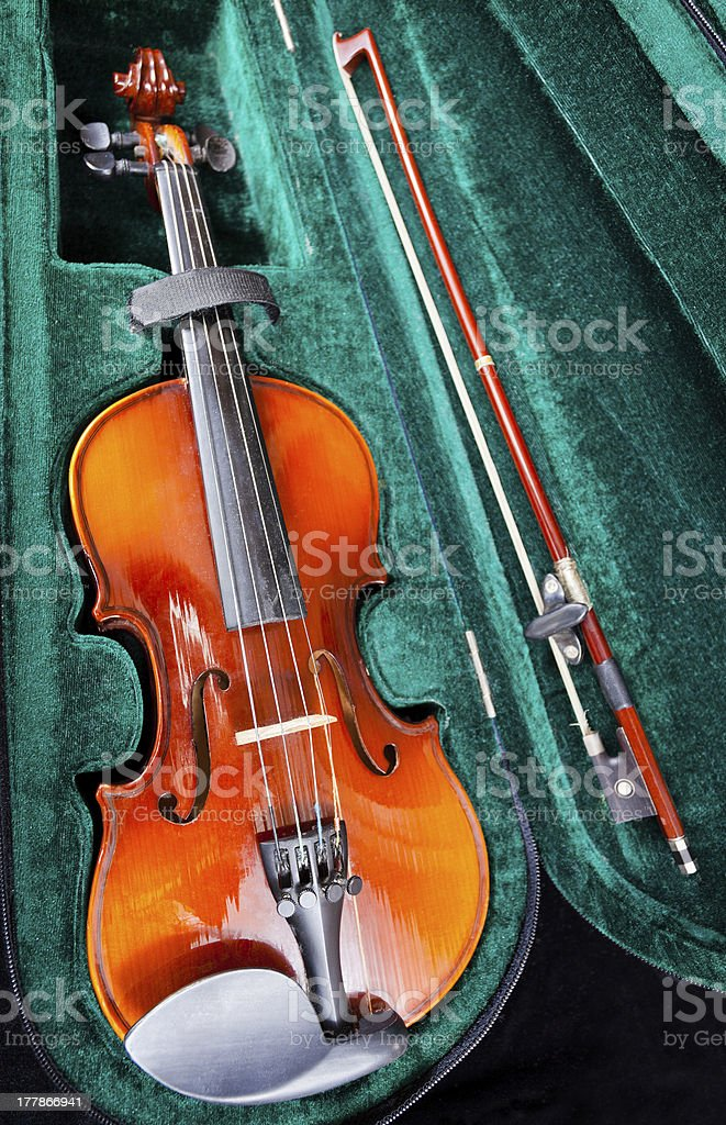 small violin with bow in green velvet case stock photo