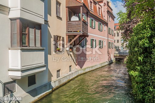 istock Small water canal in the old town of Augsburg, Germa 1311431303