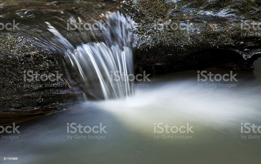 Small Waterfall Over Log royalty-free stock photo