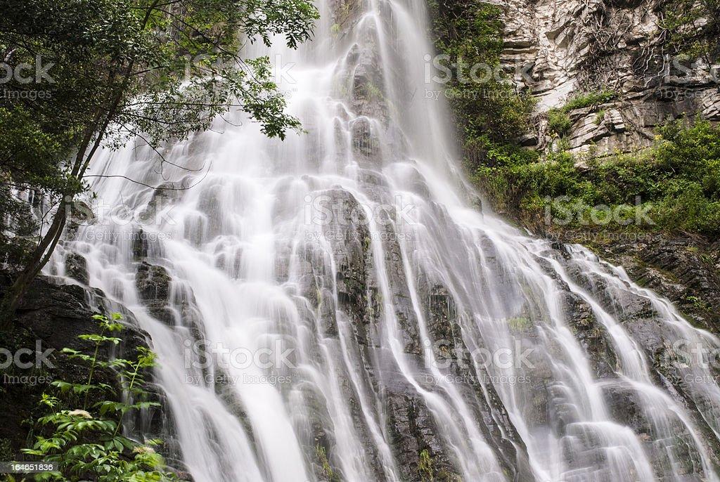 Small waterfall rushing royalty-free stock photo