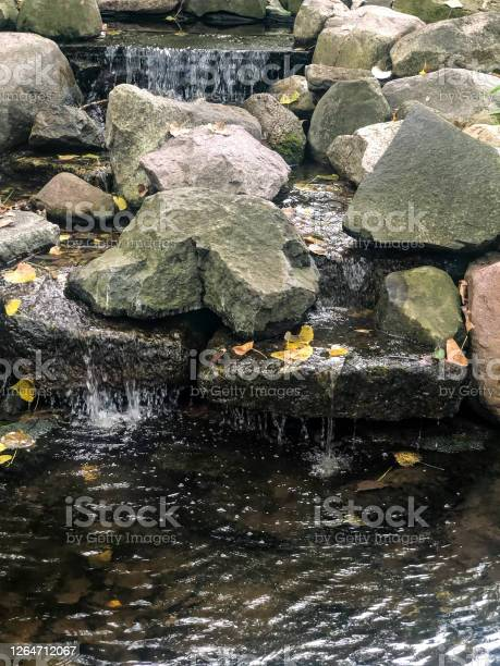 Photo of Small waterfall trickling over rocks