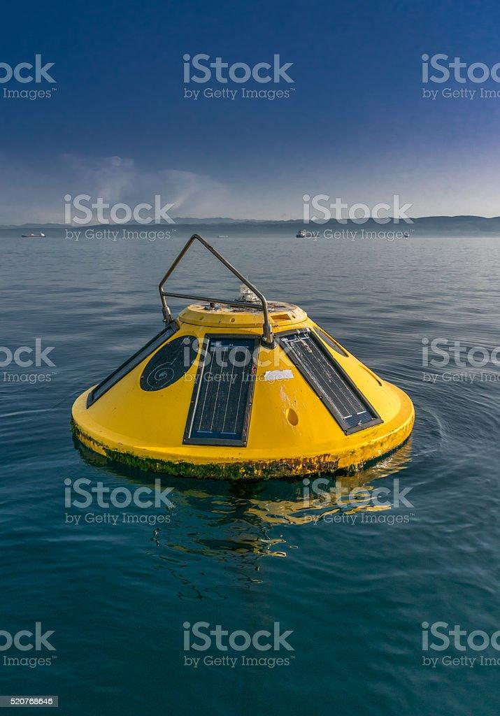 Small weather oceanographic buoy stock photo