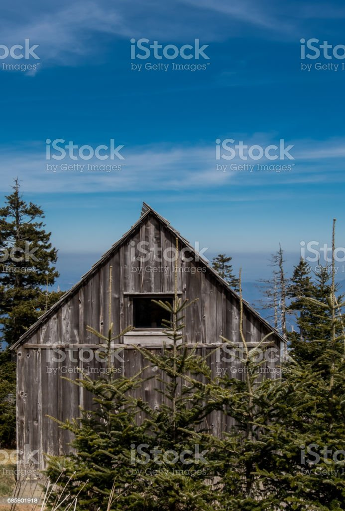 Small Weathered Cabin High on Mountain Top stock photo