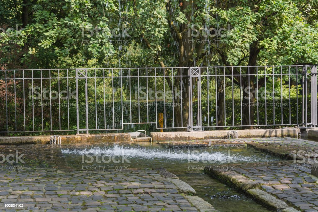 Small weir waterfall in a public park stock photo