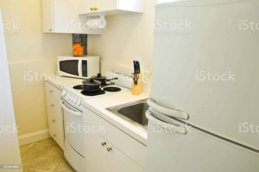 Small White Apartment Efficiency Kitchen Appliances Stock ...