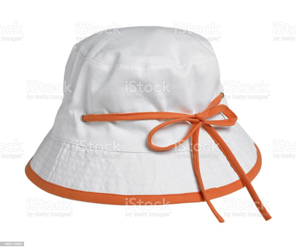 Small white cap with an orange bow stock photo