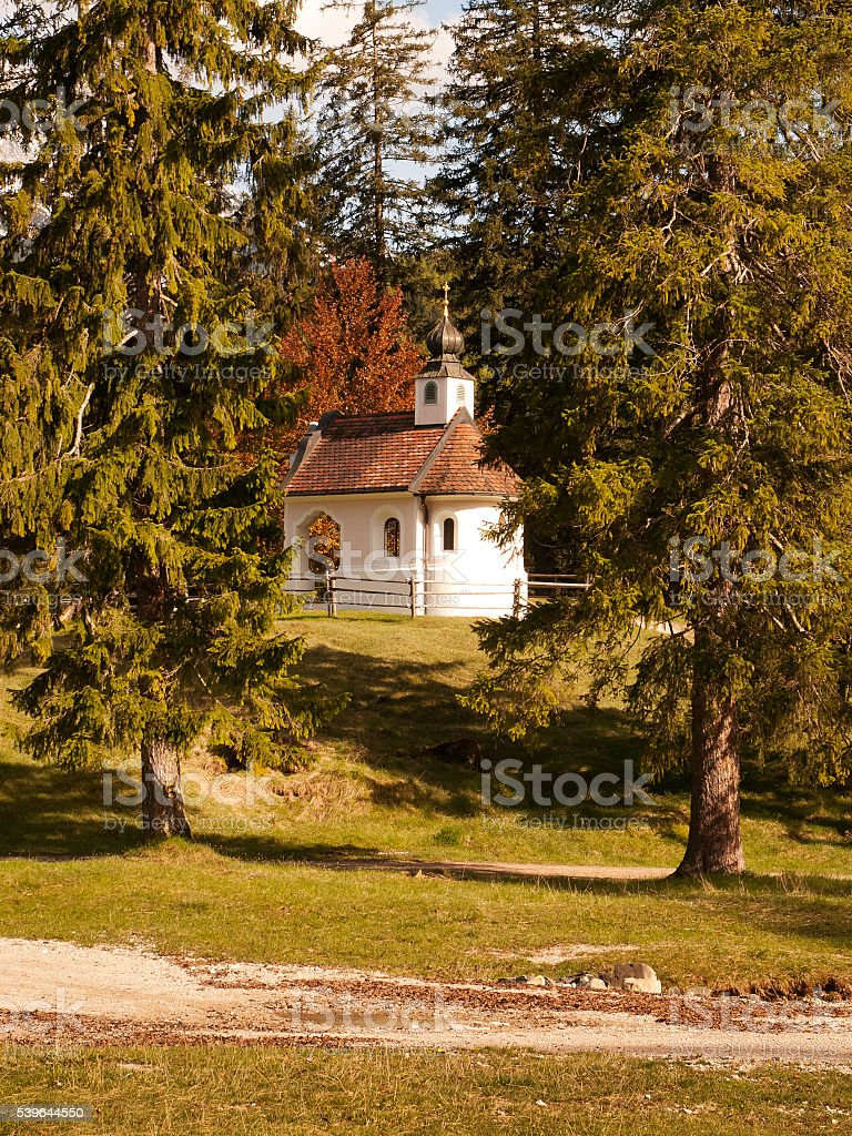 Small white chapel among trees near Mittenwald in Bavaria stock photo