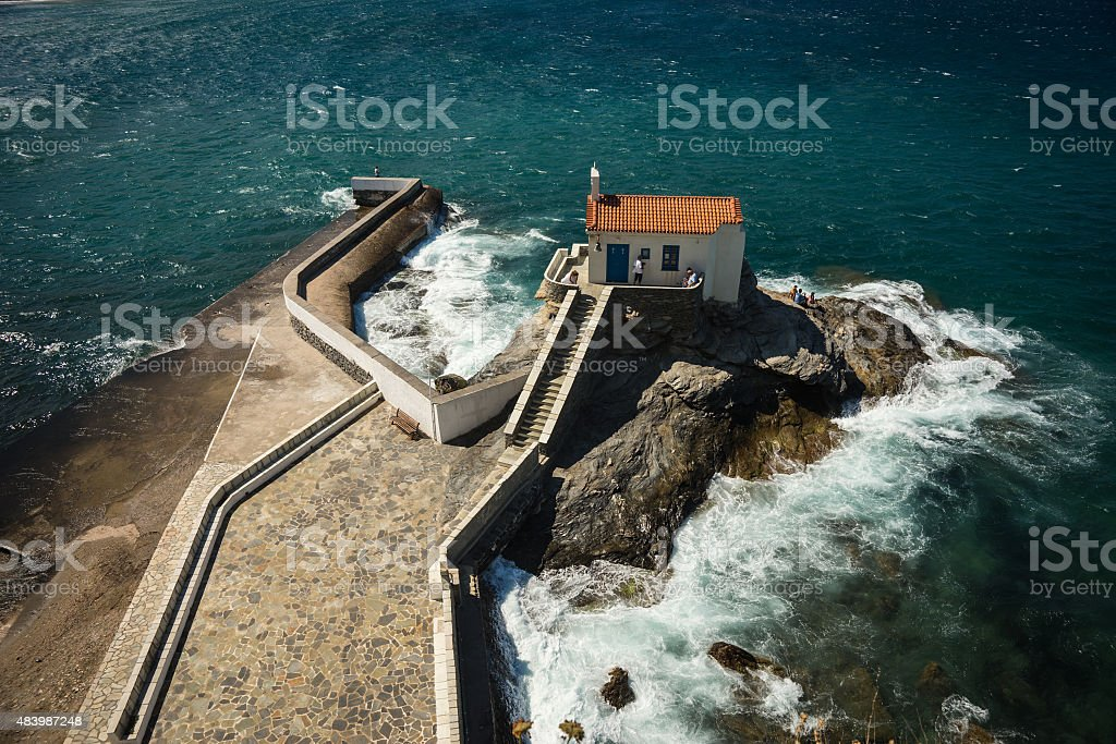 Small white church on the beach, Andros, Greece stock photo