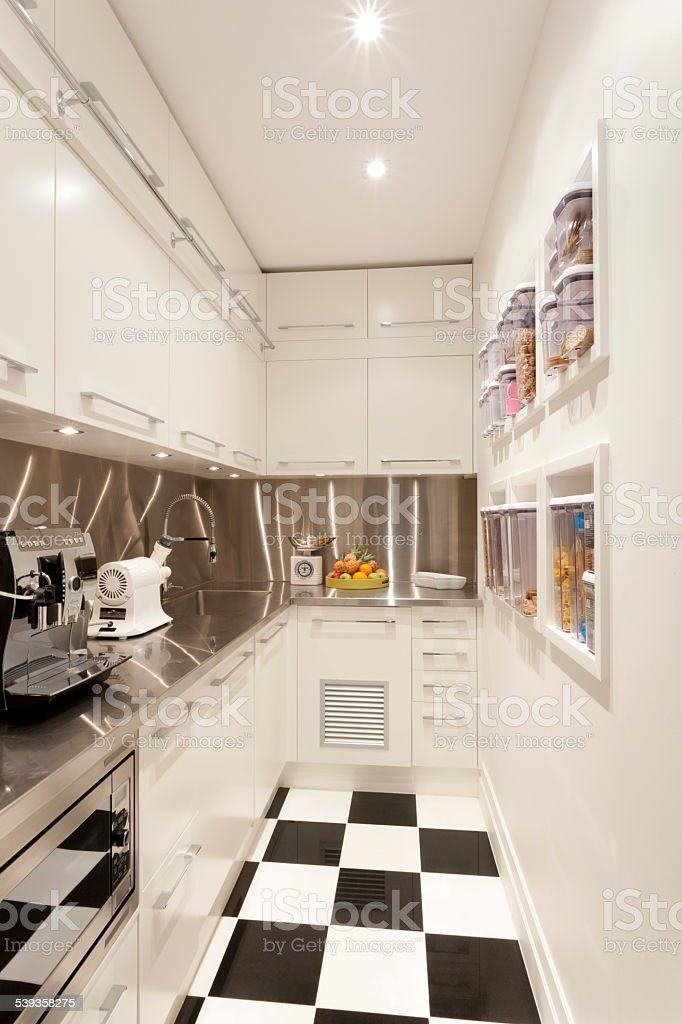 Small white coloured kitchen stock photo