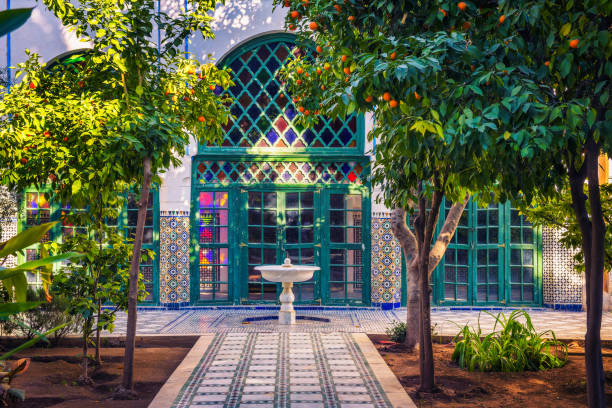 Small white fontaine among orange trees of Jardin Majorelle, Marrakech, Morocco stock photo