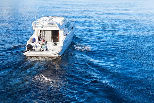 Small white pleasure motorboat