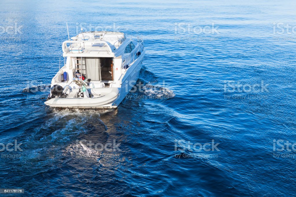 Small white pleasure motorboat stock photo