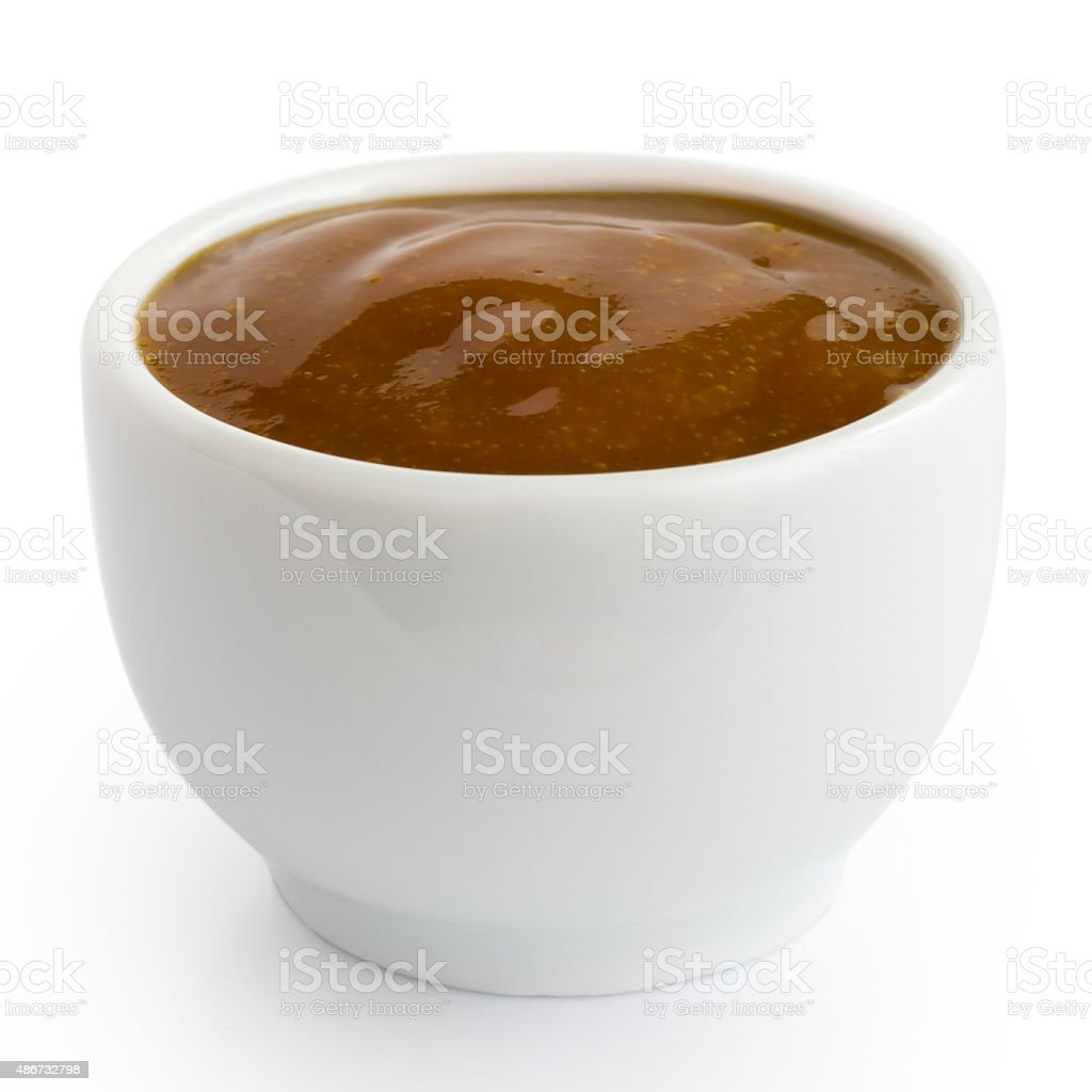 Small white pot of curry sauce dip. stock photo