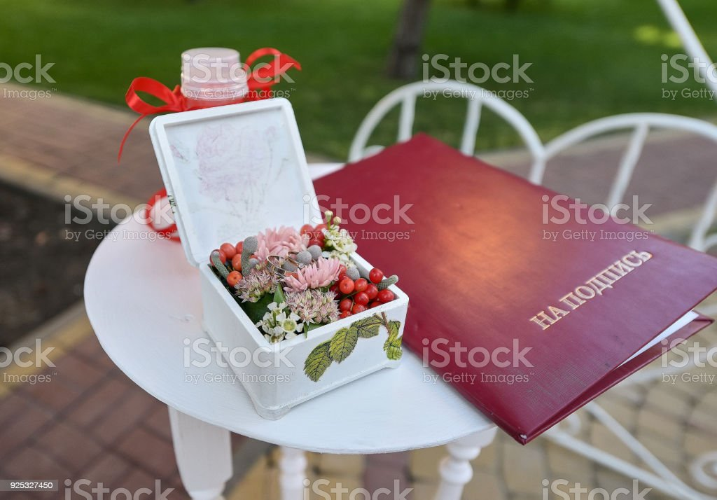 Small white table with weding accessories outdoors stock photo