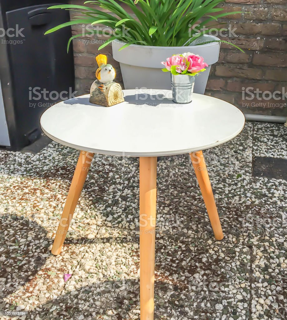 Small White Wooden Terrace Table With Decorations And Legs As