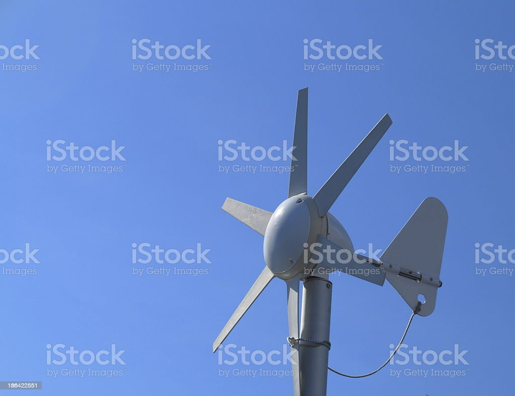 Small wind turbine. Alternative clean energy, ecology concept royalty-free stock photo