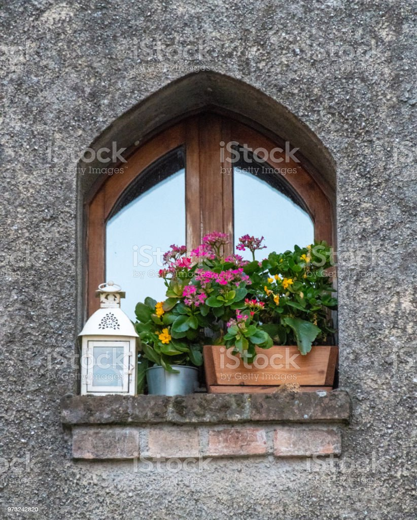 Small window box with flowers in Lake Garda, Italy stock photo