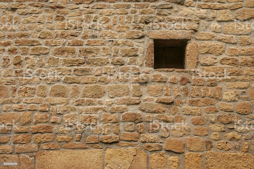 Small window in a sandstone wall royalty-free stock photo