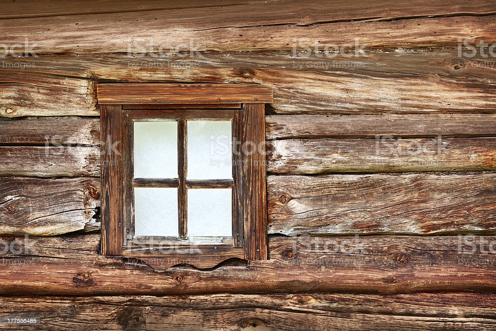 Small window in the old wooden wall stock photo