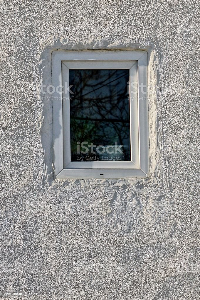 Small window on a white wall stock photo