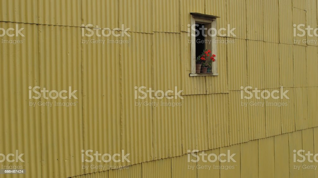 Small window on large yellow facade stock photo
