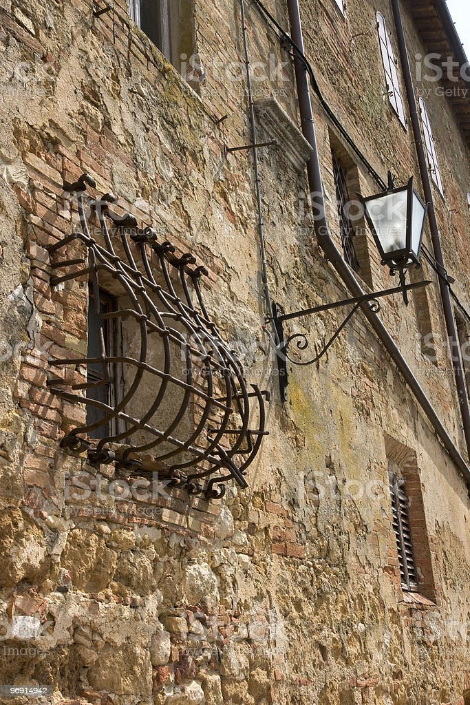 Small window with bars and lamp. royalty-free stock photo