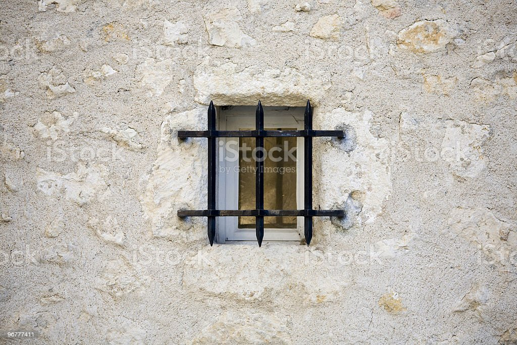 Small window with security bars royalty-free stock photo