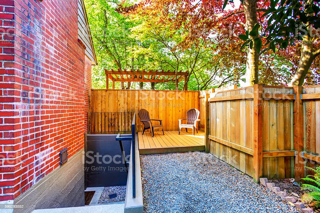 Small wooden back deck with two chairs. Стоковые фото Стоковая фотография