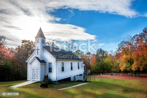 Rustic Christian wooden church in a rural small town in Maryland during Autumn with Fall Colors