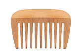 istock small wooden comb isolated on white 660530264