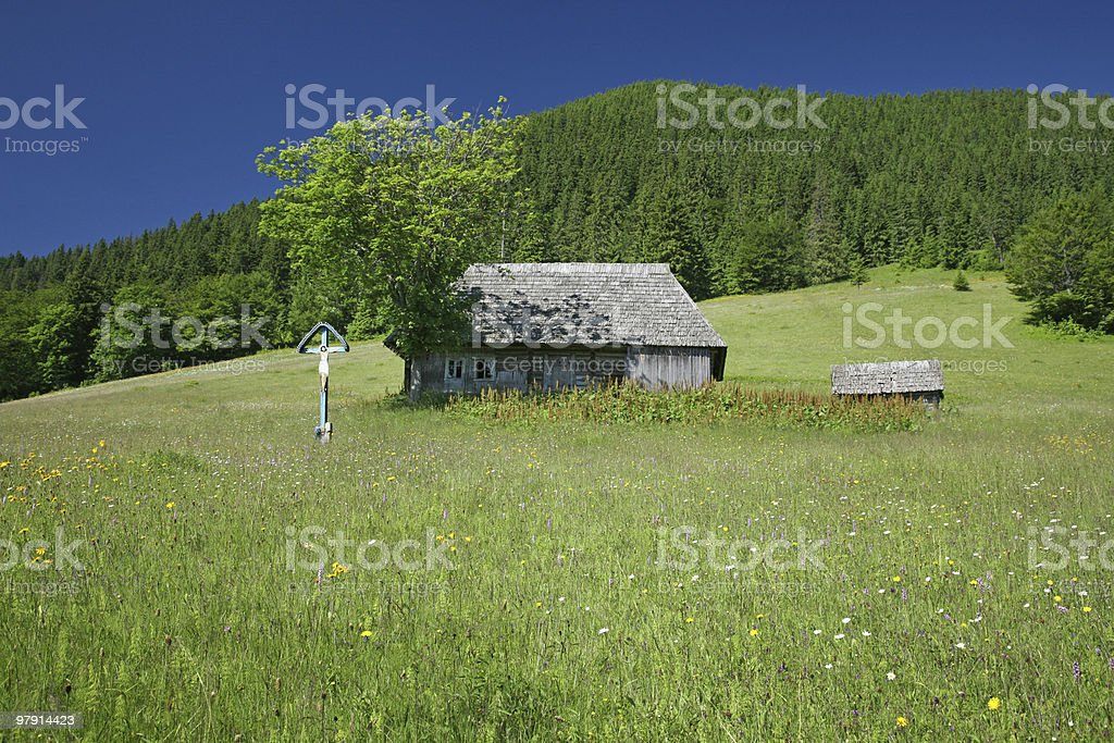 small wooden house in the mountain royalty-free stock photo