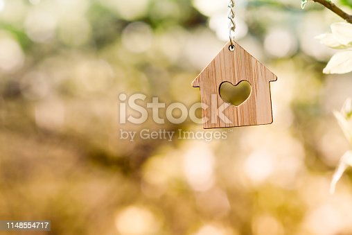 small wooden house weighs on the tree