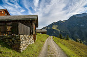 Untersch?chen, Switzerland - September 27, 2019: Small wooden houses high in the mountains close to Unterschachen in Switzerland during sunny day in late September 2019