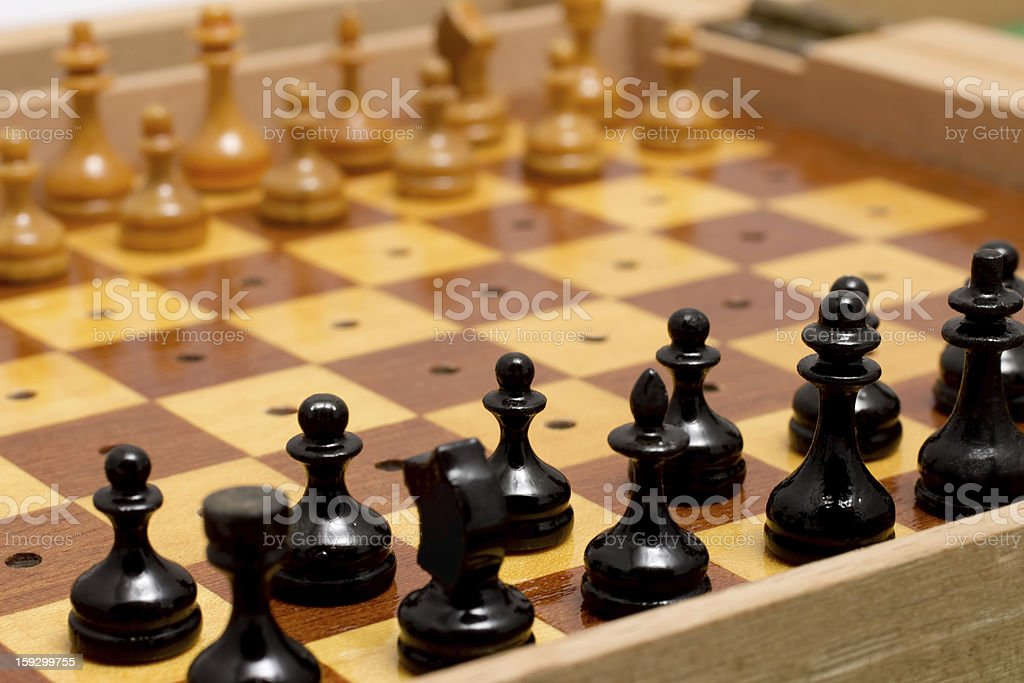 Small wooden old travel chess set royalty-free stock photo