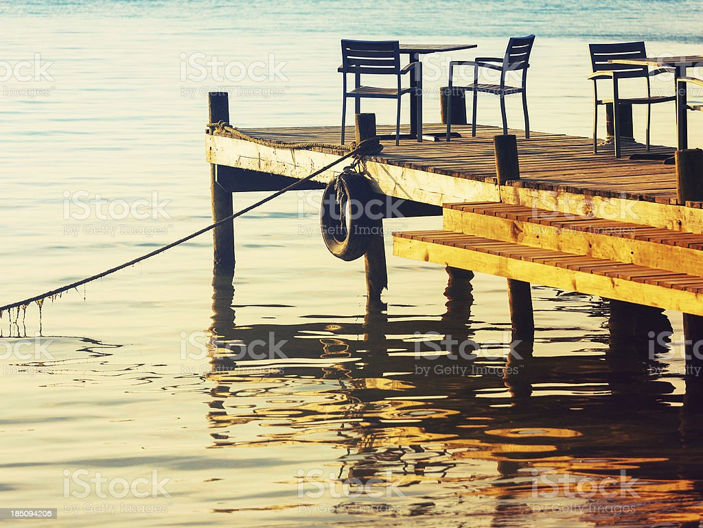 small wooden pier stock photo
