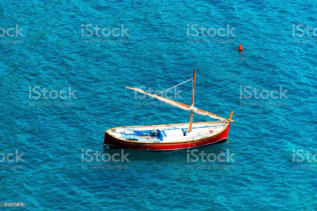 Small Wooden Sailboat at Sea stock photo