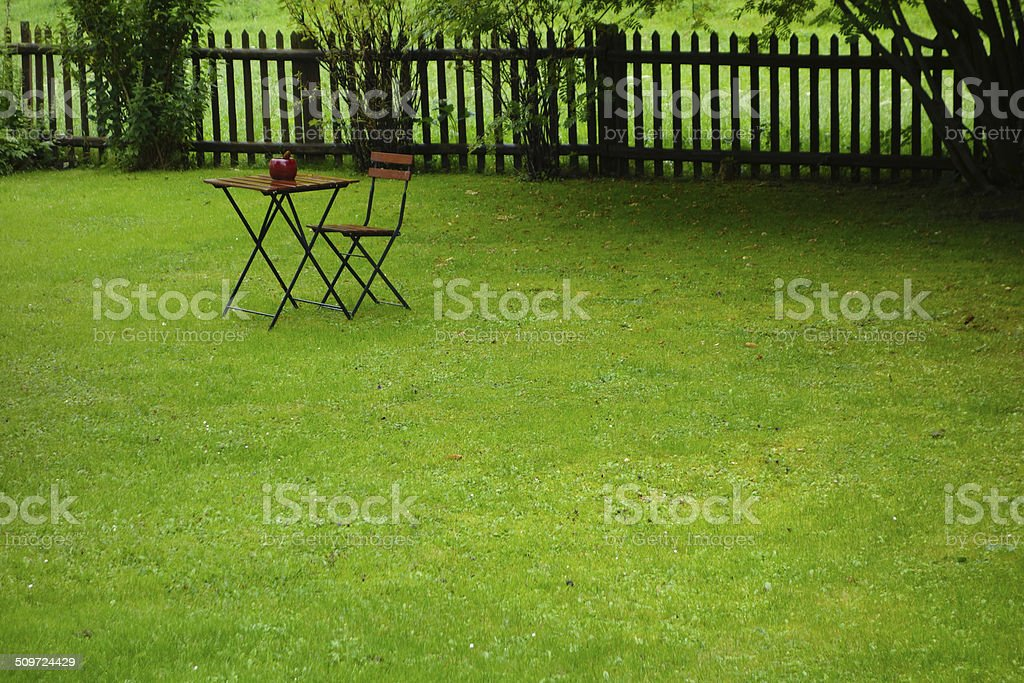 Small wooden table in the meadow stock photo