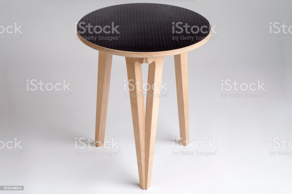Small Wooden Table or Stool with Black Vinyl Covering on Top stock photo