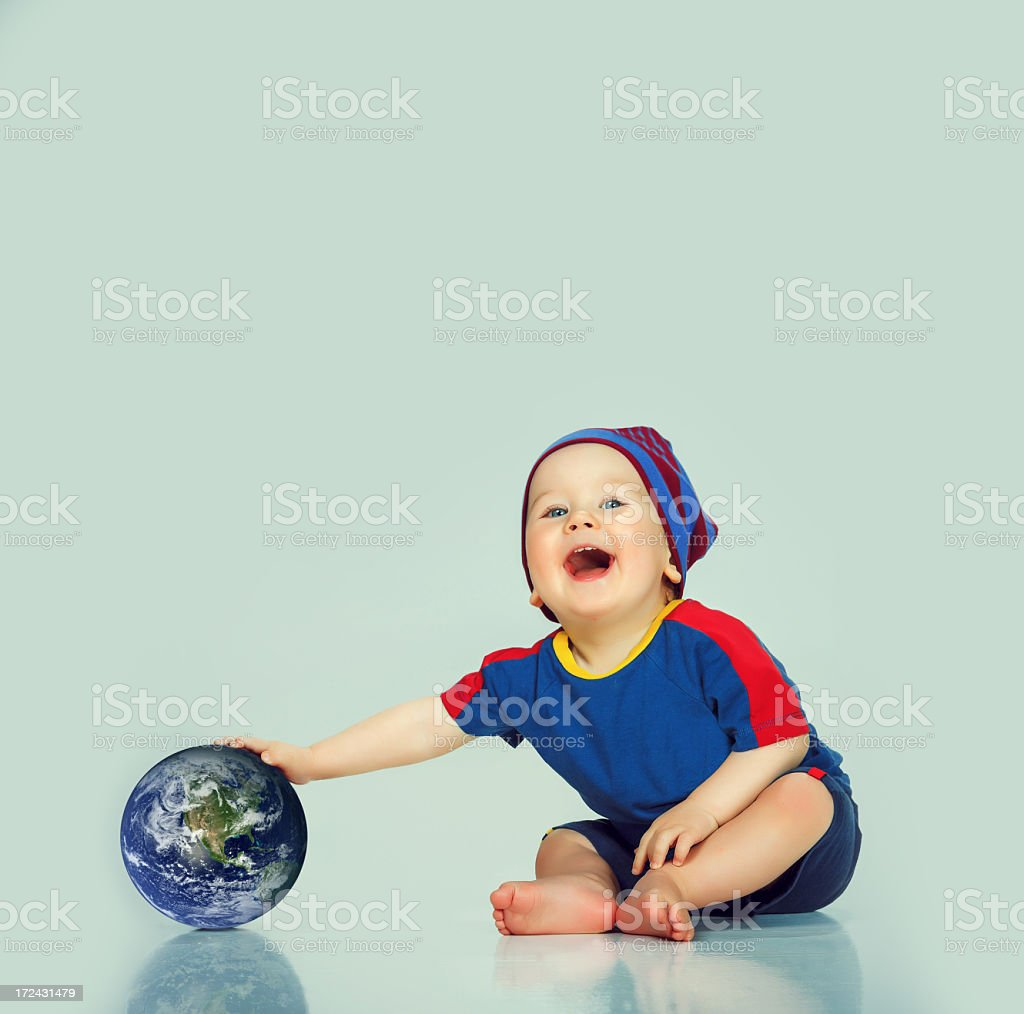 Little cute boy playing with the World