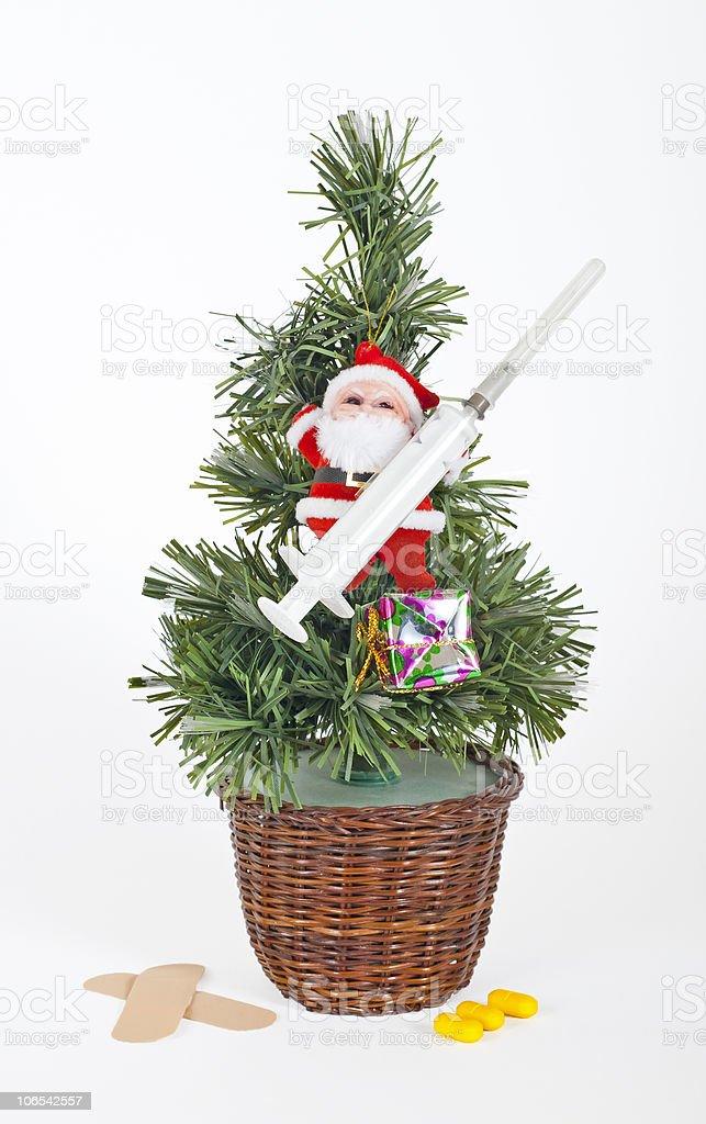 Small xmas tree with santa and medical equipment royalty-free stock photo
