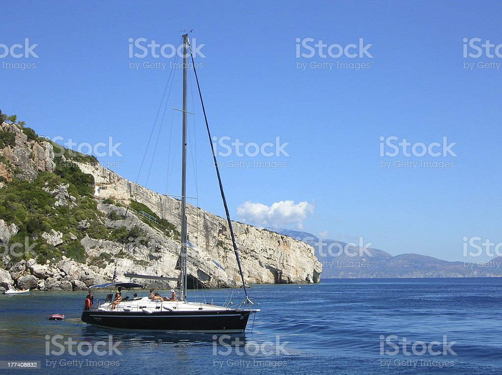 Small yacht in the middle of the Ionian sea stock photo