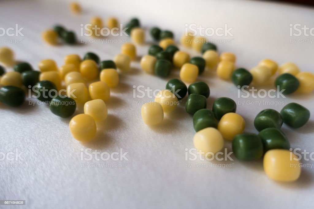 Small yellow and green candy drops stock photo