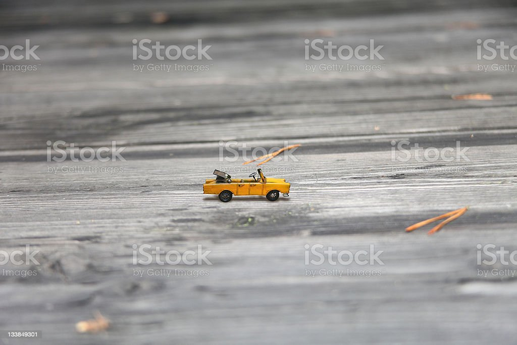 Small yellow coloured cars toy stock photo